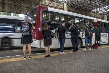 Sao Paulo, Brazil, January 03, 2017: View of people waiting for urban buses in Santo Amaro Bus Terminal, Sao Paulo, Brazil