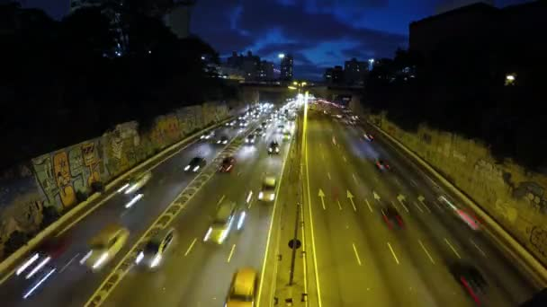 Tome lapse of Heavy traffic on the East-West connection, Radial Leste Avenue, at night, in downtown Sao Paulo.
