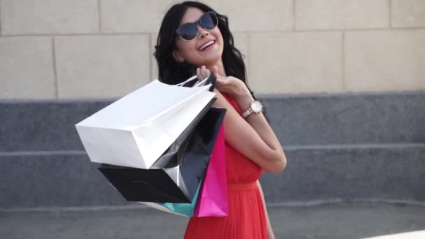 Portrait Of A Shopaholic Girl Who Holds Packages And Smiles The Brunette Is Happy With Successful Shopping She Rejoices