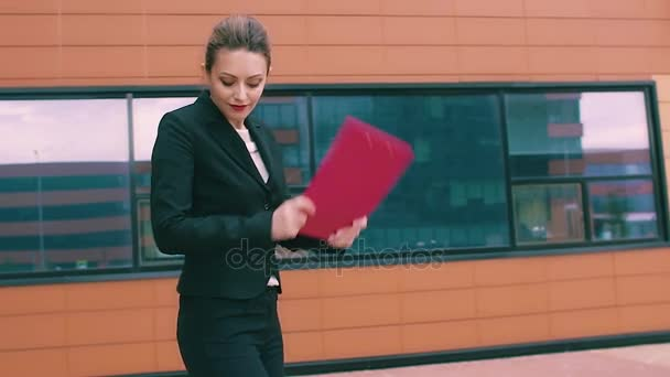 crazy dancing businessmen. business woman celebrating success and dance. beautiful woman on the background of the business building. SLOW MOTION