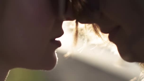 Sensual portrait close-up of two attractive girls. Friendship between two friends. slow motion