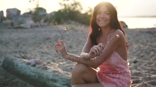 Happy and excited woman celebrating. Portrait of a sexy girl in a cocktail dress at sunset. slow motion