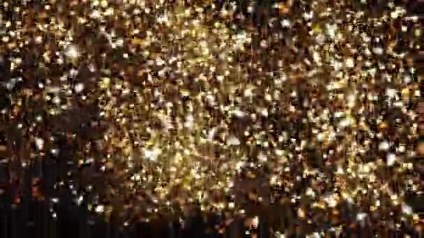 Abstraktní pozadí s zářící bokeh jiskří. Částice zlata třpytí