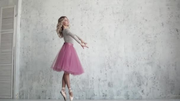 ballerina is spinning on toes in pointe shoes. beautiful young ballet dancer. pirouette in slow motion