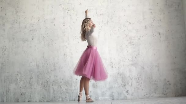 graceful ballerina beautifully dances in a classic tutu and pointe. slow motion