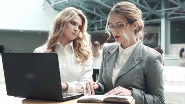 girl manager at a meeting with the client. two business women talking at a conference