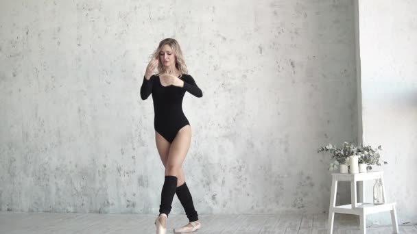 young girl ballet dancer in black bodysuit and pointe dance on tiptoe. slow motion