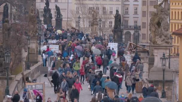 people on Charles Bridge  in Prague - PRAGUE / CZECH REPUBLIC - MARCH 19, 2017