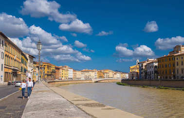 The colorful riverside of River Arno in the city of Pisa - PISA ITALY - SEPTEMBER 13, 2017