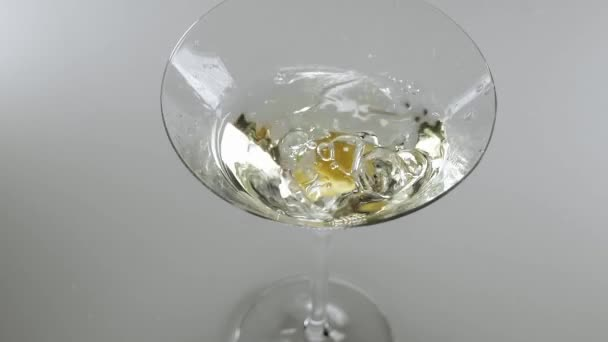 b4c145473ef8 Close up shot of martini cocktail with olive - a classic drink– stock  footage