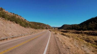 Endless road through the desert of Utah