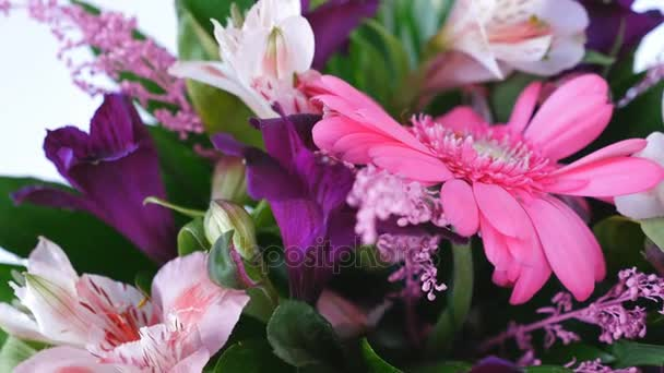 close-up, Flowers, bouquet, rotation on white background, floral composition consists of Russus, Alstroemeria, solidago, gerbera