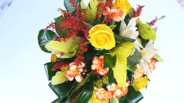 view from above, rotation on white background, floral composition consists of Rose penny lane, Carnation, Cymbidium orchid, solidago, Chrysanthemum santini, Russus, aspidistra