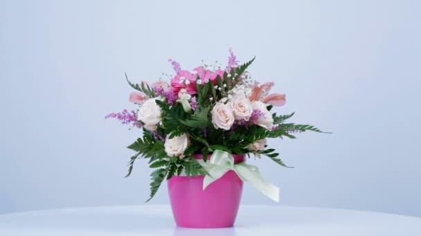 Flowers, bouquet, rotation on white background, floral composition consists of gerbera, Eustoma, Rose yana creamy, Alstroemeria, solidago, gypsophila Arachniodis Rose.