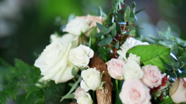 close-up, Flower bouquet in the rays of light, rotation, consists of Rose cappuccino, Snowflake rose, Rose yana creamy, Plamosus, eucalyptus, solidago, Rose of avalanche.