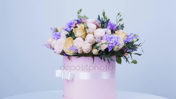 Flowers, bouquet, rotation on white background, floral composition consists of Rose of avalanche, Rose pion-shaped, Carnation, Eustoma, solidago, eucalyptus, Hiperikum.