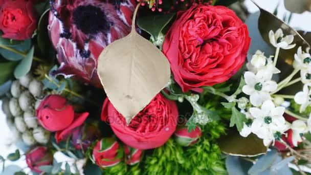 view from above, Flowers, bouquet, rotation, consists of Protea, Brunia green, Barbatus, Rose pion-shaped bordeaux, pistachio tree, Ornithogalum, eucalyptus, Santini