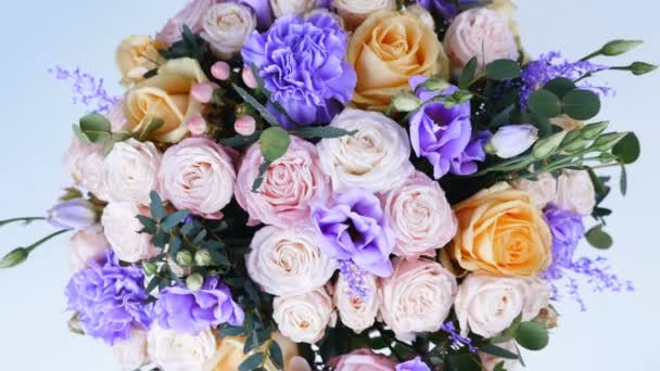 view from above, close-up, Flowers, bouquet, rotation , floral composition consists of Rose of avalanche, Rose pion-shaped, Carnation, Eustoma, solidago, eucalyptus, Hiperikum.