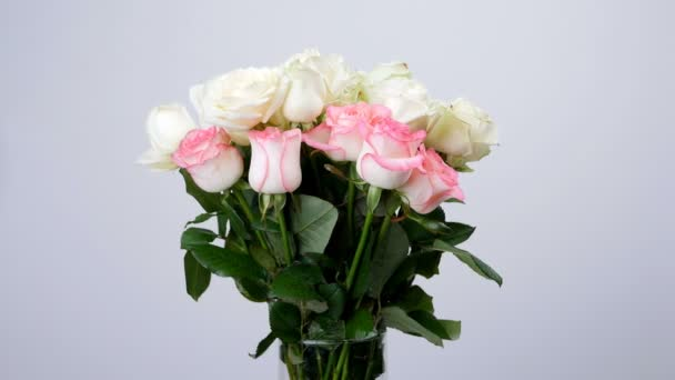 Flowers, bouquet, rotation on white background, floral composition consists of white and pink Roses . Rose dzhemilja, Rose of avalanche .Divine beauty