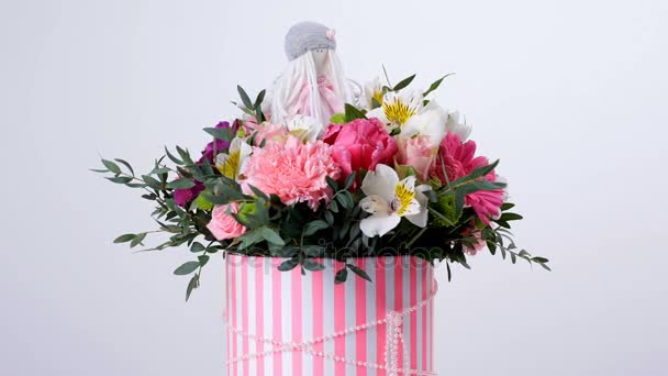 Flowers, bouquet, rotation on white background, floral composition consists of gerbera, Tulip piano, Santini , Alstroemeria, Rose odily, Orchid vanda, eucalyptus