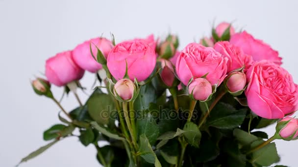 close-up, Flowers, bouquet, rotation on white background, floral composition consists of pink Roses pion-shaped