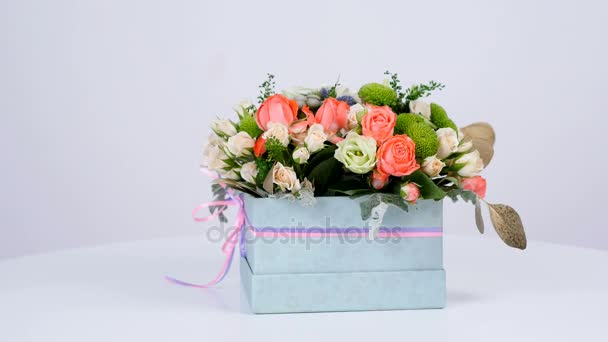 Flowers, bouquet, rotation on white background, floral composition consists of eucalyptus, cineraria, Rose cream grace, Rose barbados, Eustoma, solidago, Santini ,