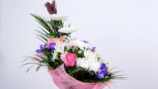 Flowers, bouquet, rotation on white background, floral composition consists of Leucadendron, Chrysanthemum anastasis, Amaryllis pink, Orchid vanda, Alstroemeria,