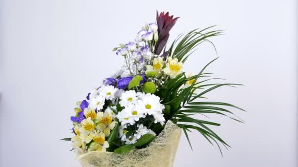 Flowers, bouquet, rotation on white background, floral composition consists of Alstroemeria, Chrysanthemum bacardi, Orchid vanda, Santini , gypsophila, Eustoma,