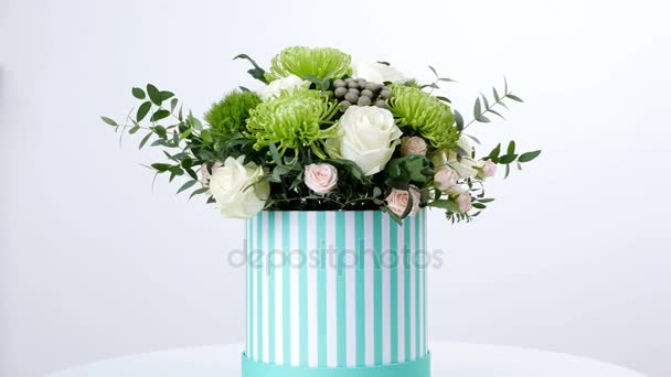 Flowers, bouquet, rotation on white background, floral composition consists of Brunia green, Rose of avalanche, Rose yana creamy, Santini , gypsophila, eucalyptus, pistachio