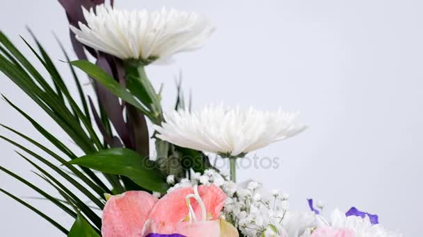 close-up, Flowers, bouquet, rotation on white background, floral composition consists of Leucadendron, Chrysanthemum anastasis, Amaryllis pink, Orchid vanda, Alstroemeria,