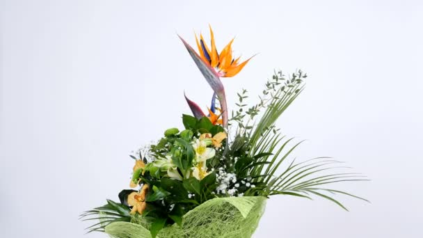 Flower bouquet on white background, rotation, the floral composition consists of Strelitzia, Chrysanthemum, Phalaenopsis orchid.