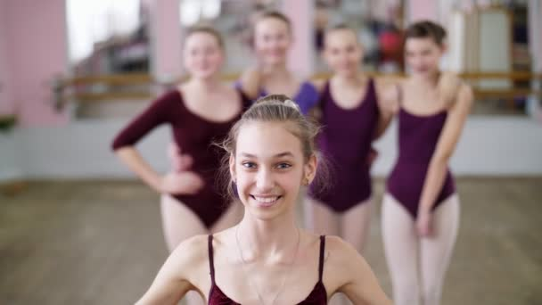 3a5a9e48ce0d16 Portrait of a young girl ballet dancer in a lilac ballet leotard, smiling,  sending an air kiss, gracefully performing a ballet figure.– stock footage
