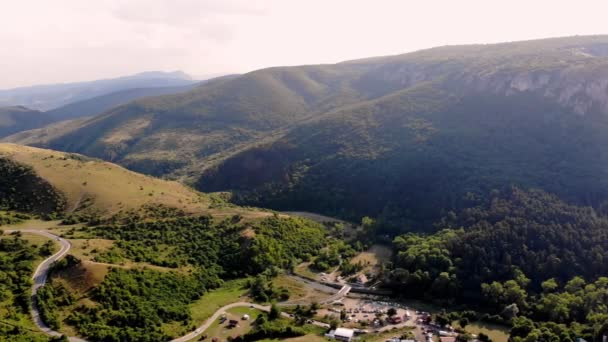 aero. panoramic view of mountains sheltered by dense green coniferous forest. automobile highway near entrance of Grand Canyon, Turda Gorge, Cluj county, Romania, Europe, Transylvania, Carpathians,