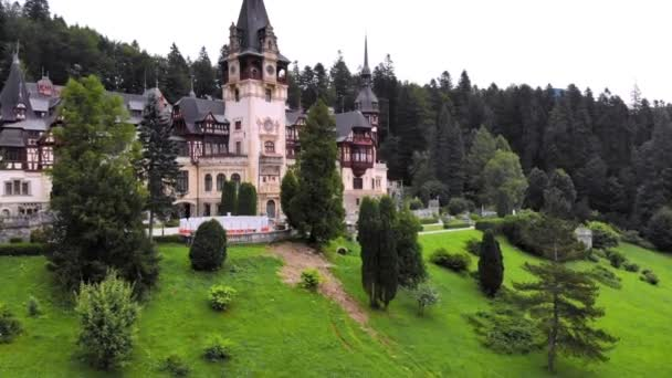 Peles castle. Sinaia, Romania . the castle is surrounded by beautiful carpathian mountains.