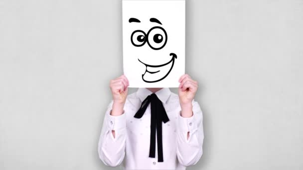portrait, teenager holds white paper sheet with curious smiley drawing, animation, covering face. emotions, Imagination, creativity, successful idea concept.