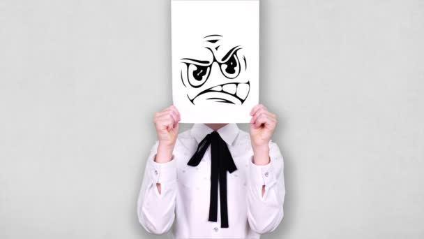 portrait, teenager holds white paper sheet with furious smiley drawing, animation, covering face. emotions, Imagination, creativity, successful idea concept.