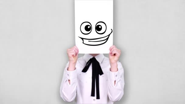 portrait, teenager holds white paper sheet with excited smiley drawing, animation, covering face. emotions, Imagination, creativity, successful idea concept.