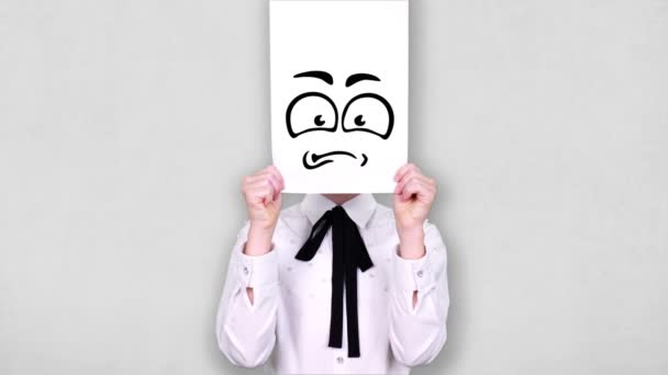 portrait, teenager holds white paper sheet with hate smiley drawing, animation, covering face. emotions, Imagination, creativity, successful idea concept.