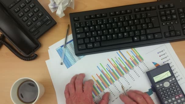Accountant at his desk checking printed statements