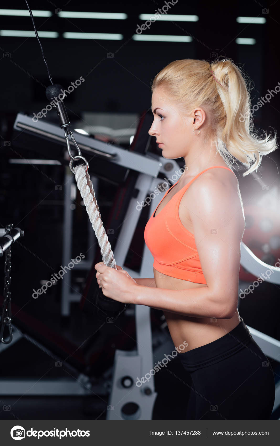 Young Fitness Woman Demonstrate Crossover Exercises The Pectoral