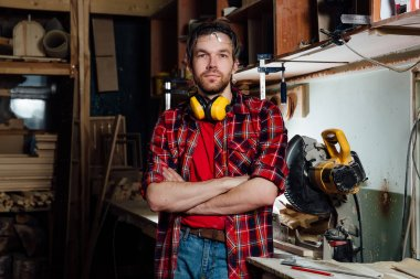 portrait of the joiner in the workshop.
