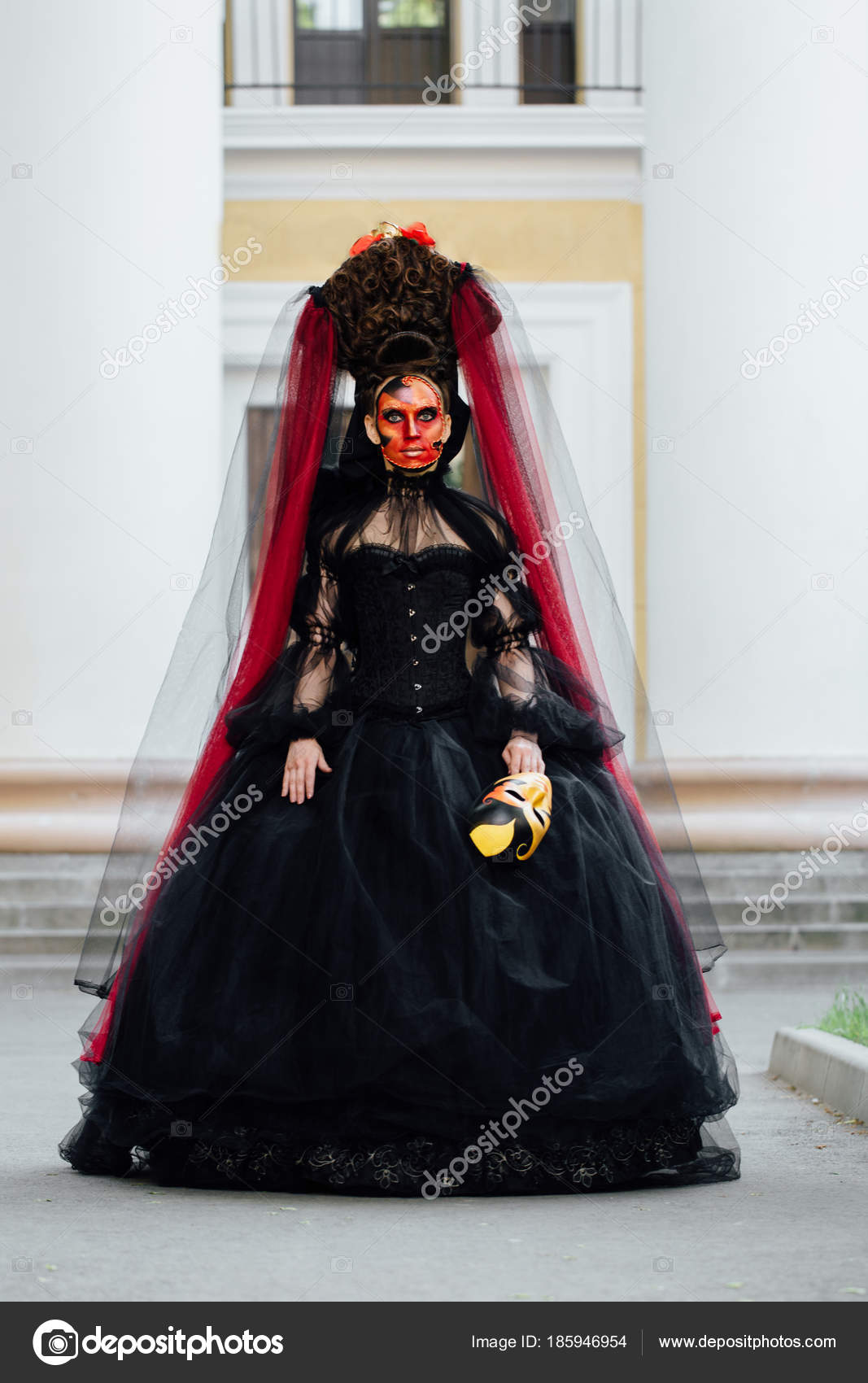 Witch portrait in black vintage dress  Woman widow with red