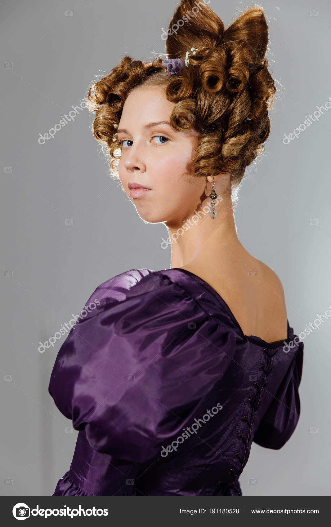 Beautiful Young Woman In Vintage Dress With Designer Hair Ball