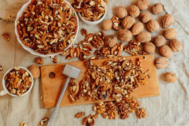 Assortment of nuts. Bowl of walnuts on wooden texture. Walnuts a