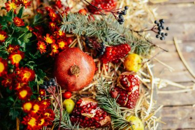 Christmas background with Garnet, berries, fruit and cones, sele