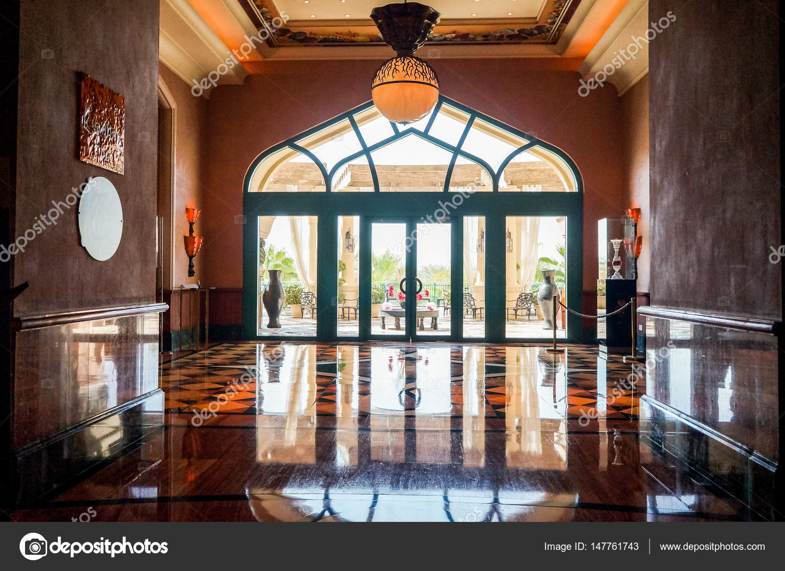 bright orange color in the interior with marble floor of the hotel photo by sablinstanislav