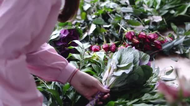 Florist put exotic flower on bouquet