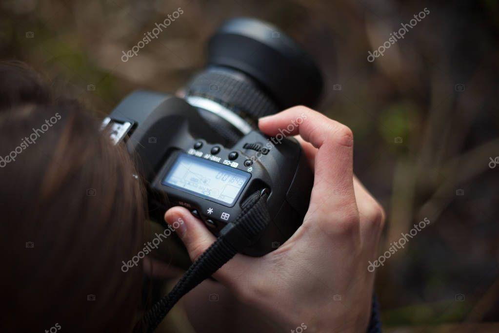 Photographer at work. SLR camera close-up