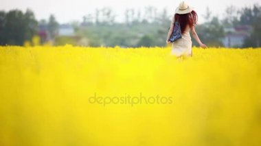 Young girl happily walks through field of wildflowers