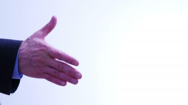 Business partners handshake - men and women - 4 k
